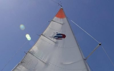 white sail with red tip