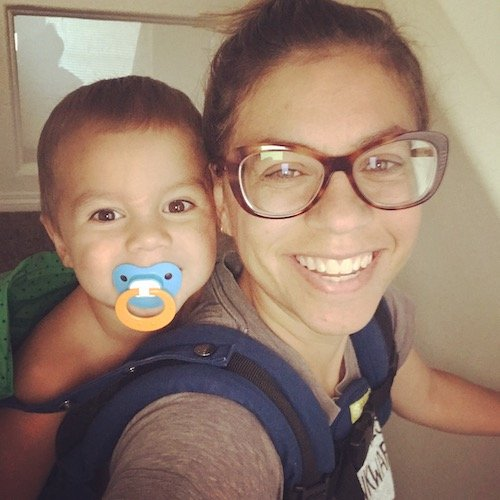 woman wearing glasses with small child
